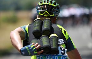 A cyclist of Russia's Tinkoff cycling team carrying feeding bottles for his teammates rides during a sunny day as part of the 162,5 km seventh stage of the 103rd edition of the Tour de France cycling race on July 8, 2016 between L'Isle-Jourdain and Lac de Payolle.  / AFP / KENZO TRIBOUILLARD        (Photo credit should read KENZO TRIBOUILLARD/AFP/Getty Images)